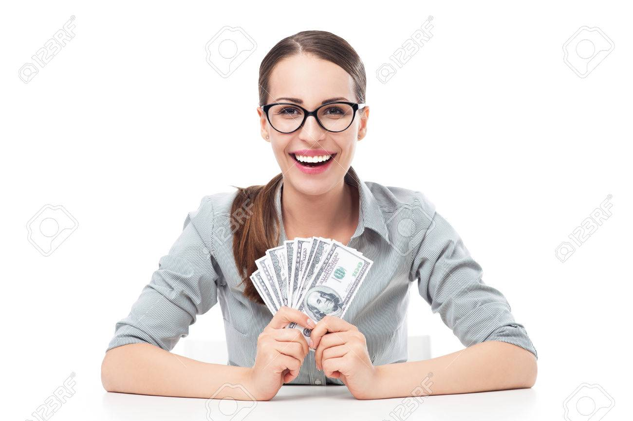 Young businesswoman holding money - 23840435
