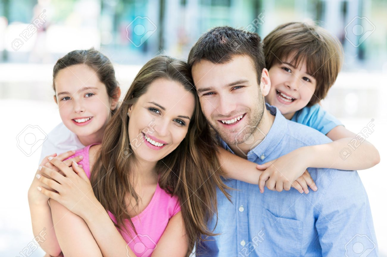 Young family smiling Stock Photo - 41624255