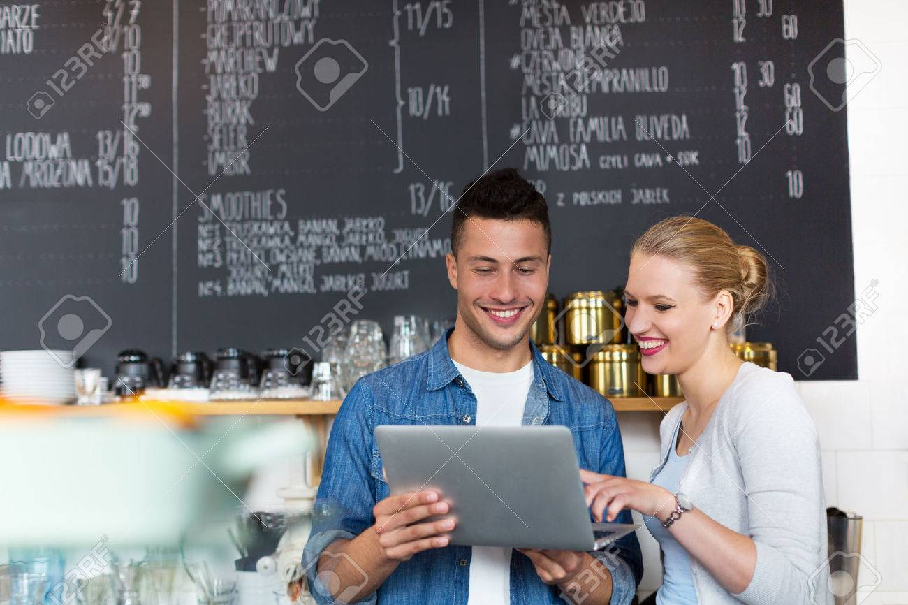 Small business owners in caf Stock Photo - 46982787