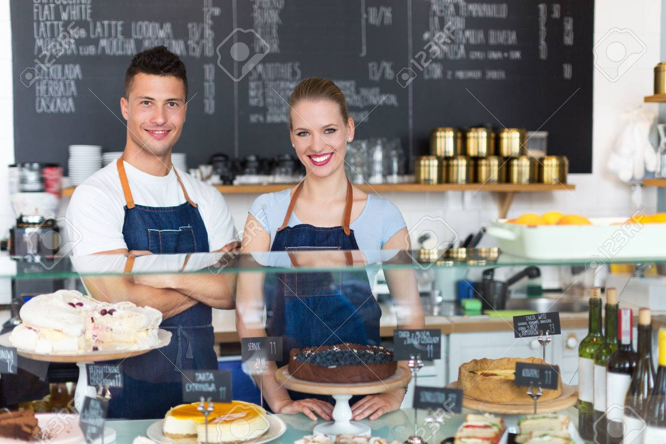 Man and woman working in a coffee shop Stock Photo - 47219690