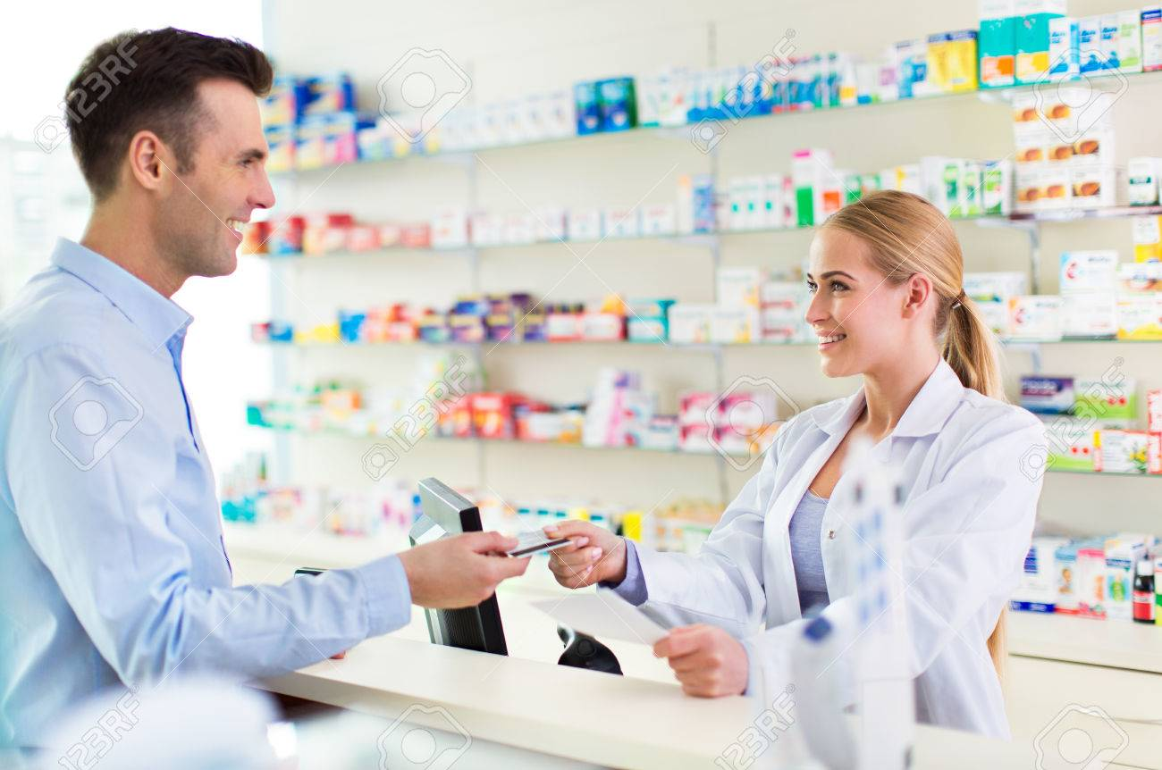 Pharmacist and client at pharmacy - 56704682