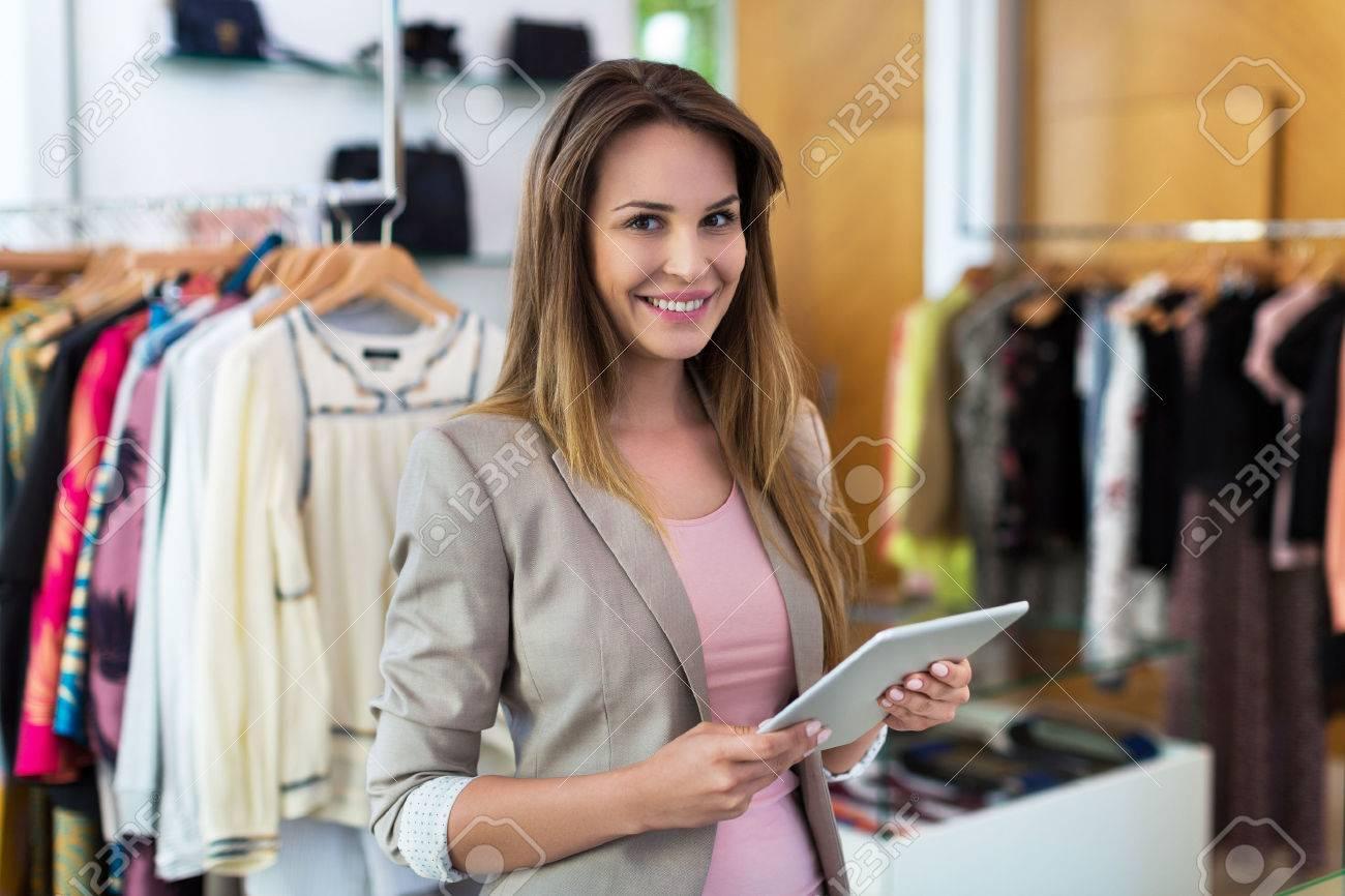 Boutique owner using a digital tablet - 57749965