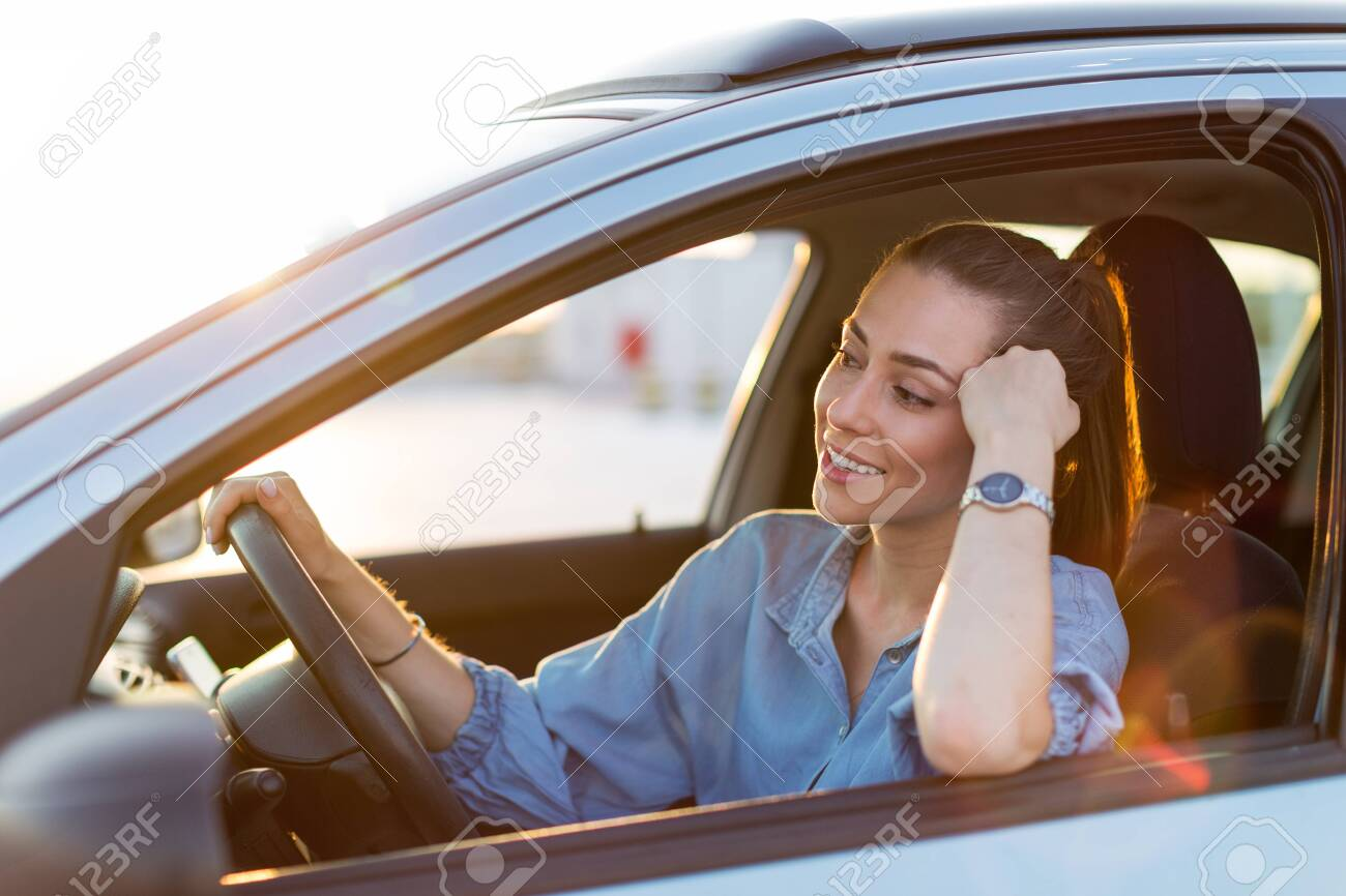 Woman traveling by car - 125164988