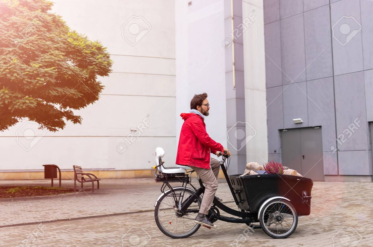 Young man going back from shopping with a cargo bike - 130738851