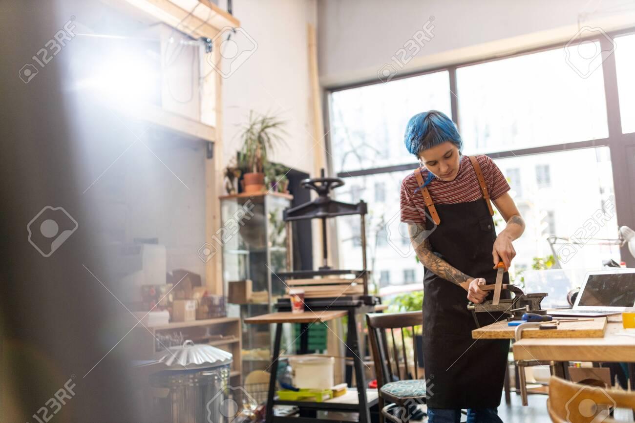 Female Carpenter In Her Workshop - 134851307