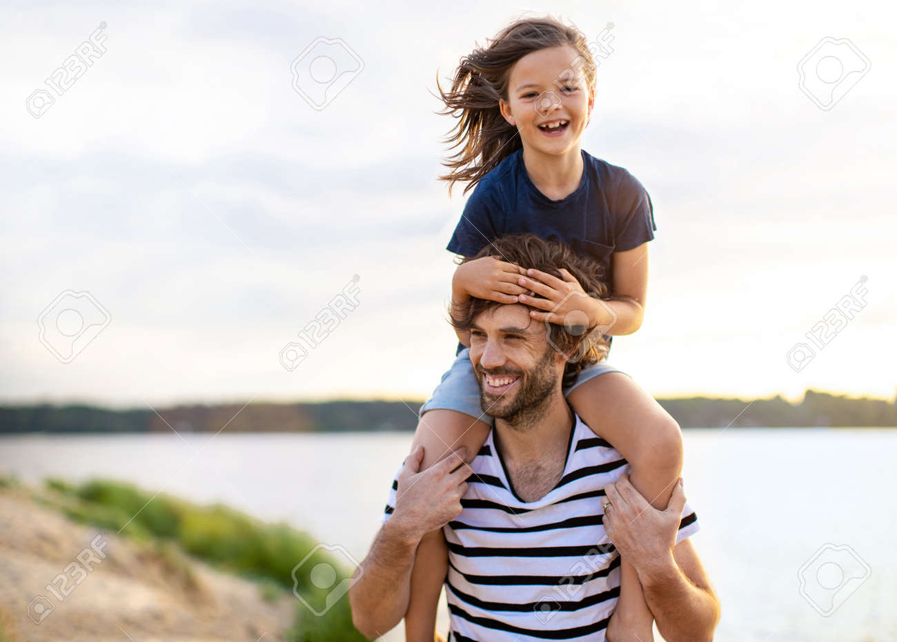 Father with a child spending the day at the beach - 149677528