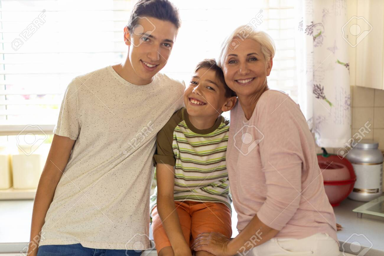 Happy mother with her two sons - 151474785