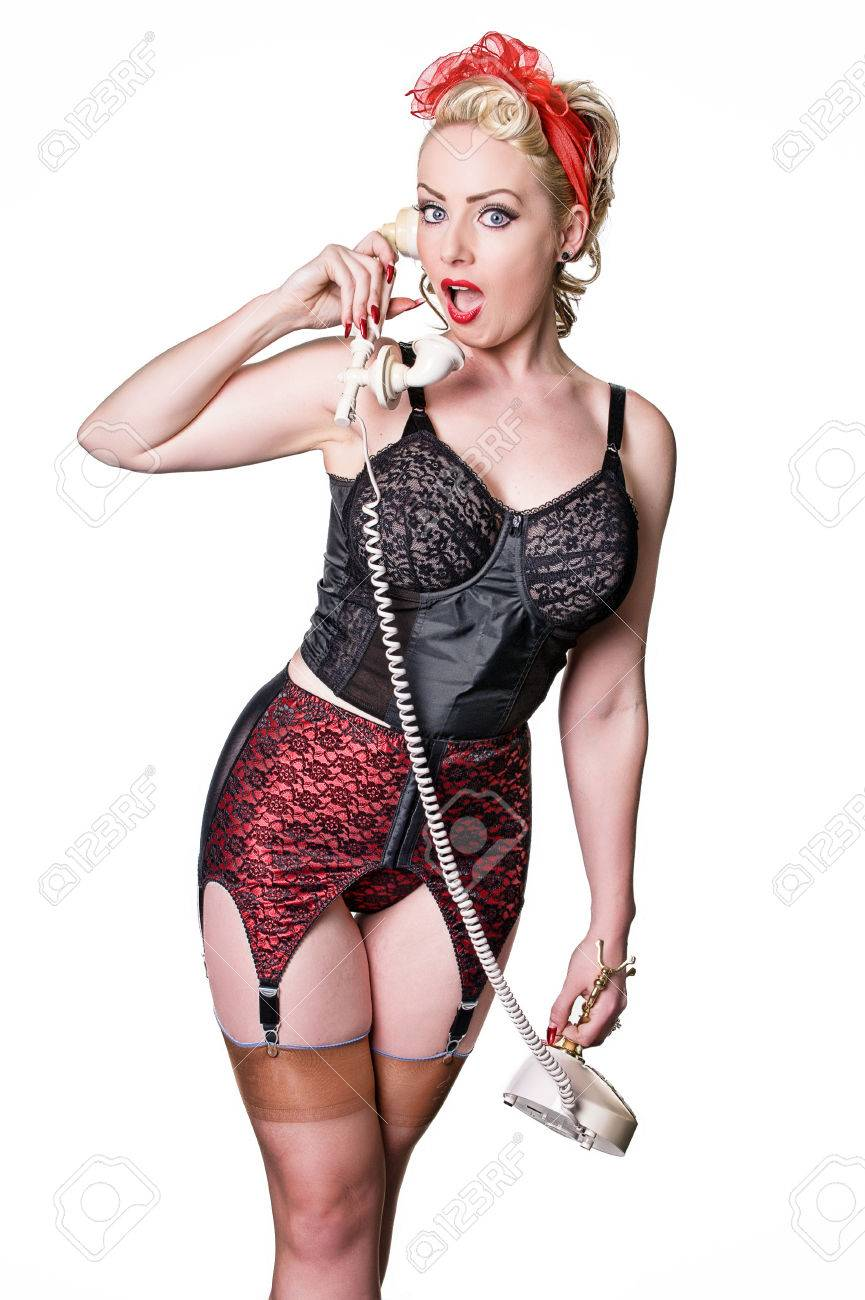 844542ead Offended retro blond beauty conversing on vintage telephone - isolated on white  Stock Photo - 23837367