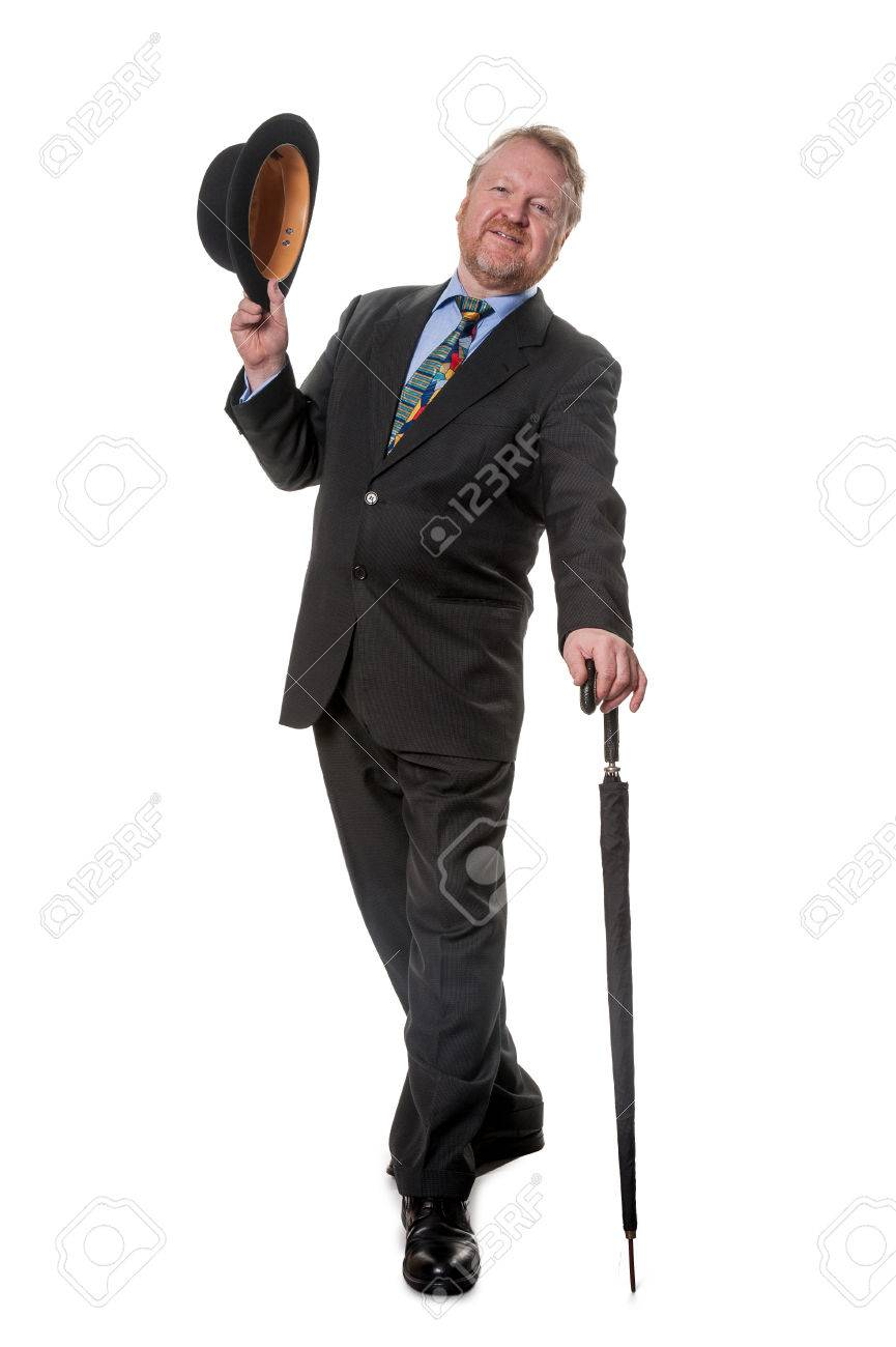 e6a5b1a0555 Happy businessman with bowler hat and umbrella Stock Photo - 23923738