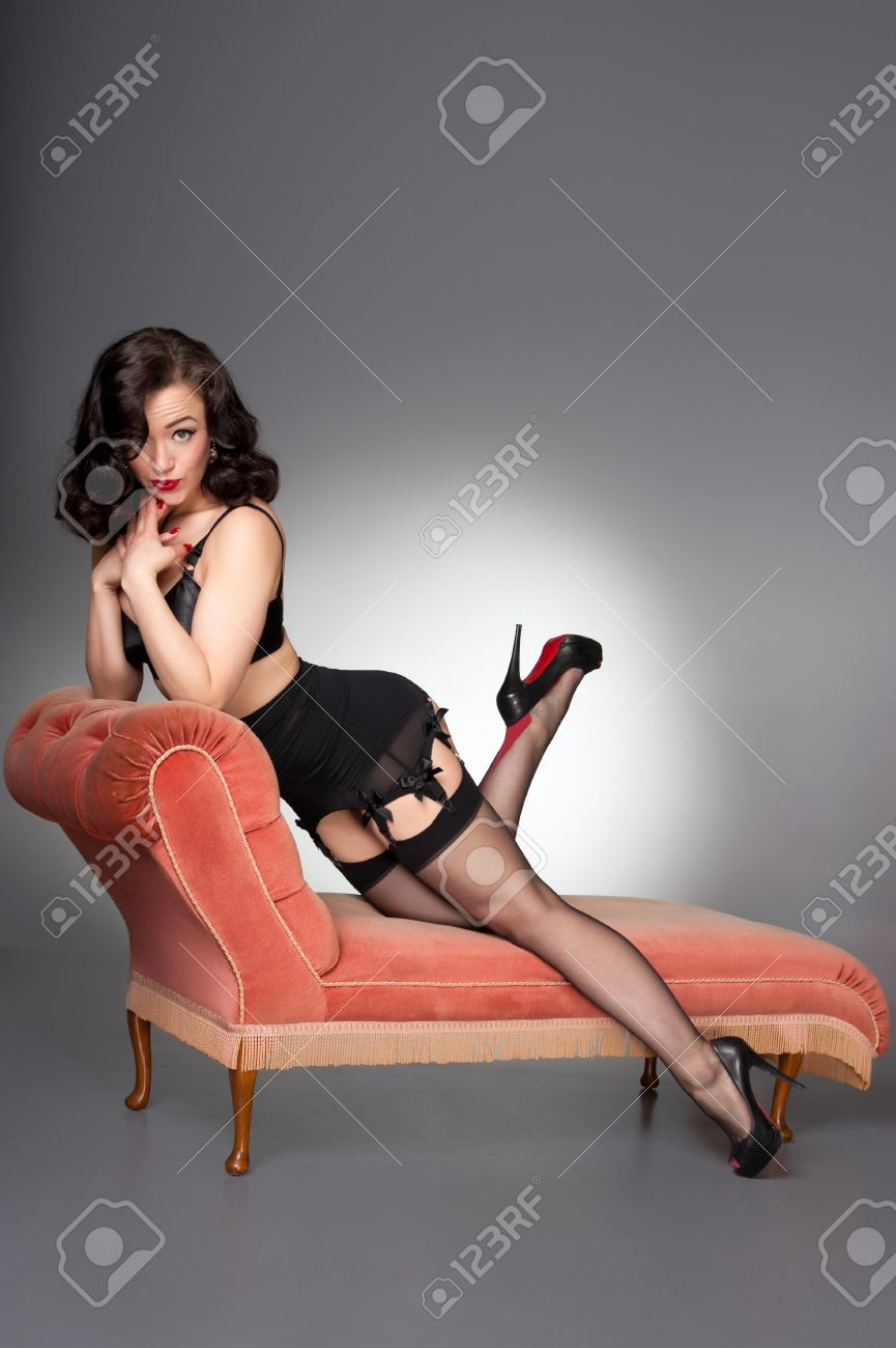88c45e862 classic pinup in black lingerie on vintage chaise Stock Photo - 23923829