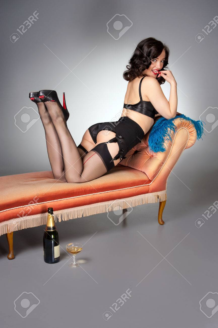 23afdd0d1 classic pinup in black lingerie on vintage chaise Stock Photo - 23923832