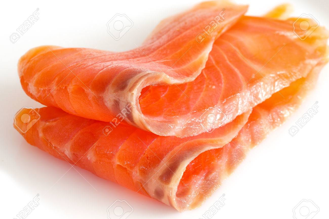 two slices of salmon on a white. Close up - 41959414