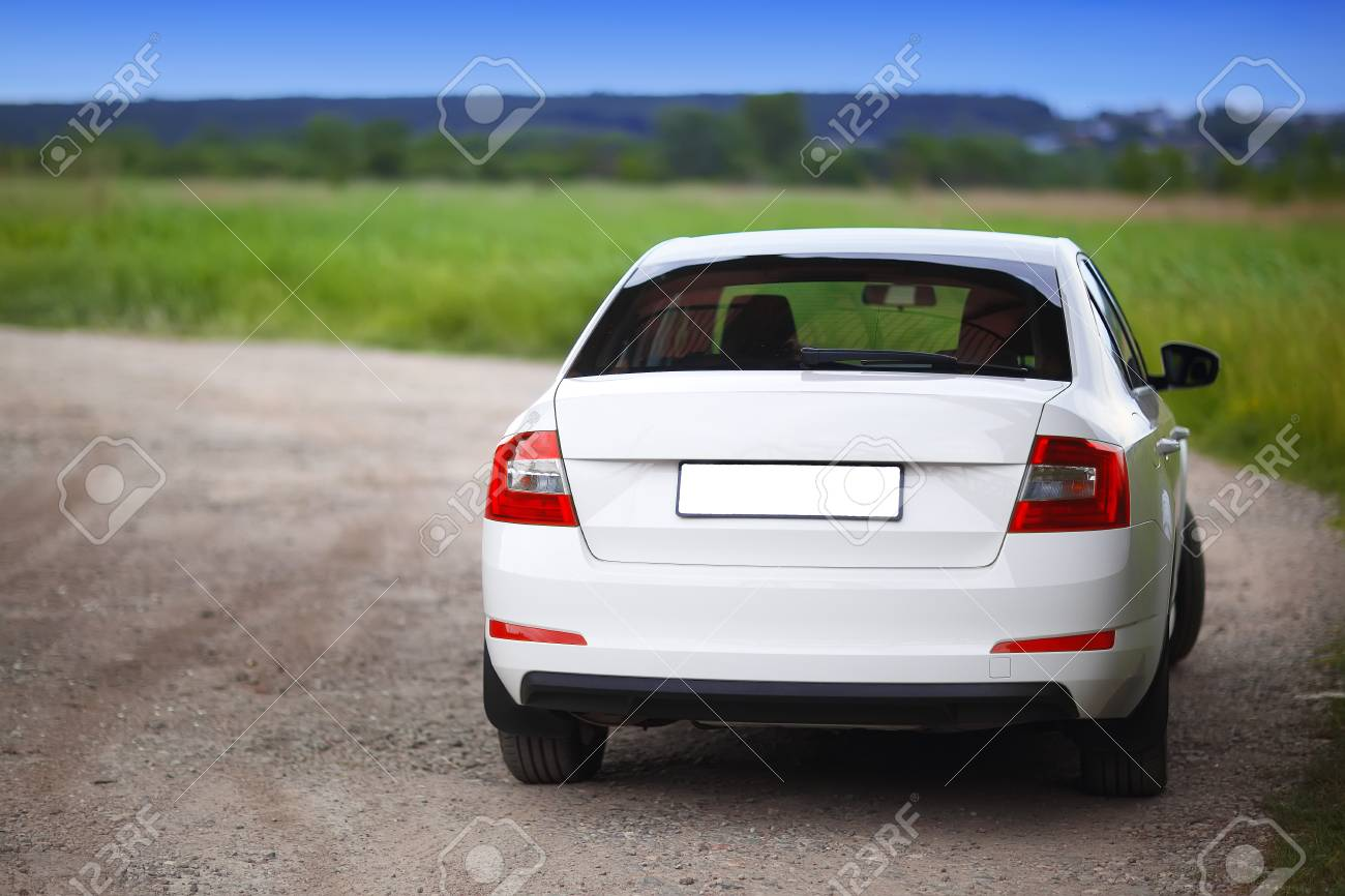 Rear-side view of a car on nature background - 78157381