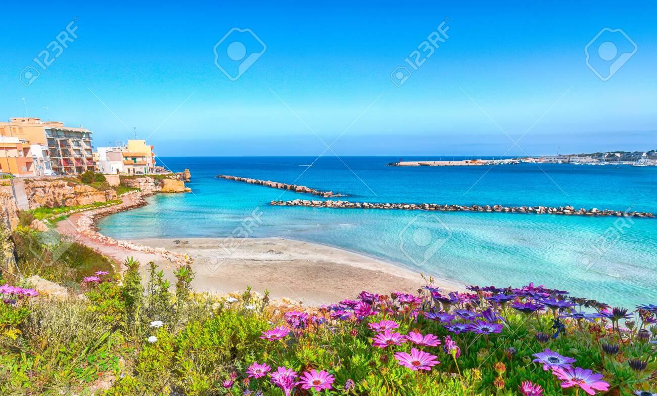 Otranto - coastal town in Puglia with turquoise sea. Italian vacation. Town Otranto, province of Lecce in the Salento peninsula, Puglia, Italy - 134182026