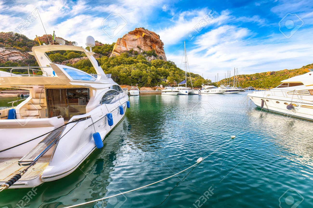 Enchanting view of Poltu Quatu port and bay with luxury yachts on Costa Smeralda. Popular travel destination of Mediterranean sea. Location: Poltu Quatu, Province of Sassari, Sardinia, Italy, Europe - 170378884
