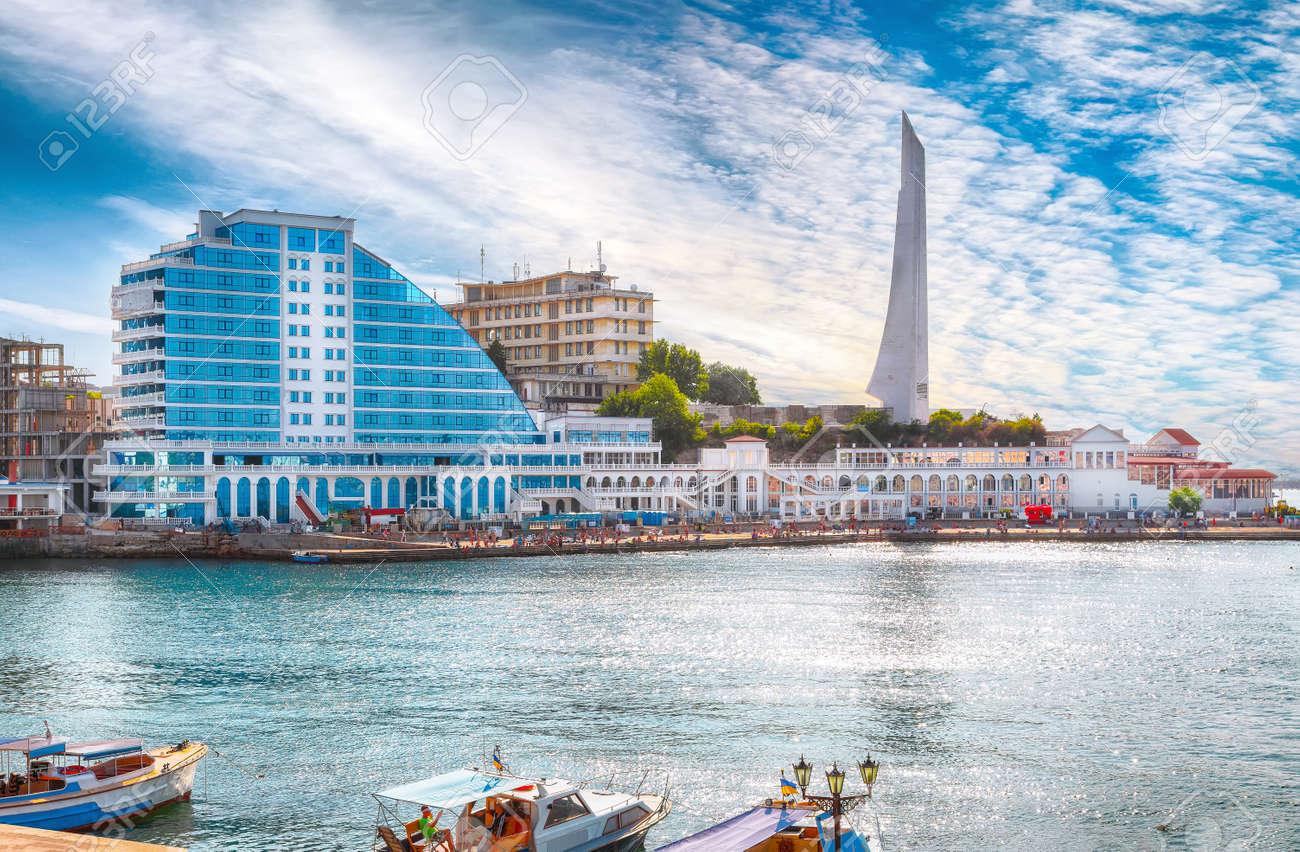 Residential complex Cape Khrustalny and the obelisk to the Hero City of Sevastopol during sunny day. Sevastopol embankment. Crimea - 170378852