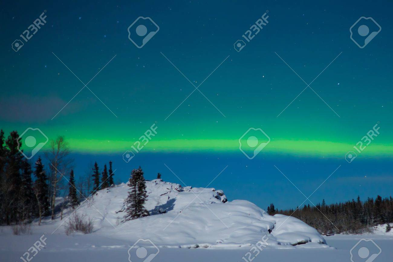 Northern Lights (Aurora borealis) over moon lit snowscape. Stock Photo - 8636506
