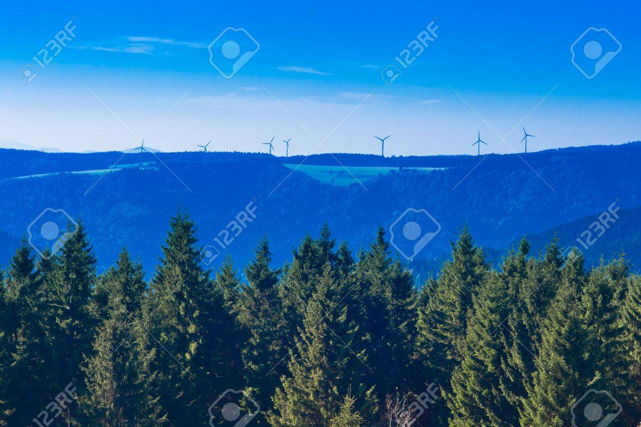 Forested landscape with windfarm at horizon in Black Forest, rural Germany. Stock Photo - 8836029