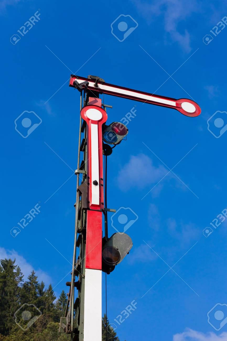 Old railway semaphore against blue sky. Stock Photo - 8837703