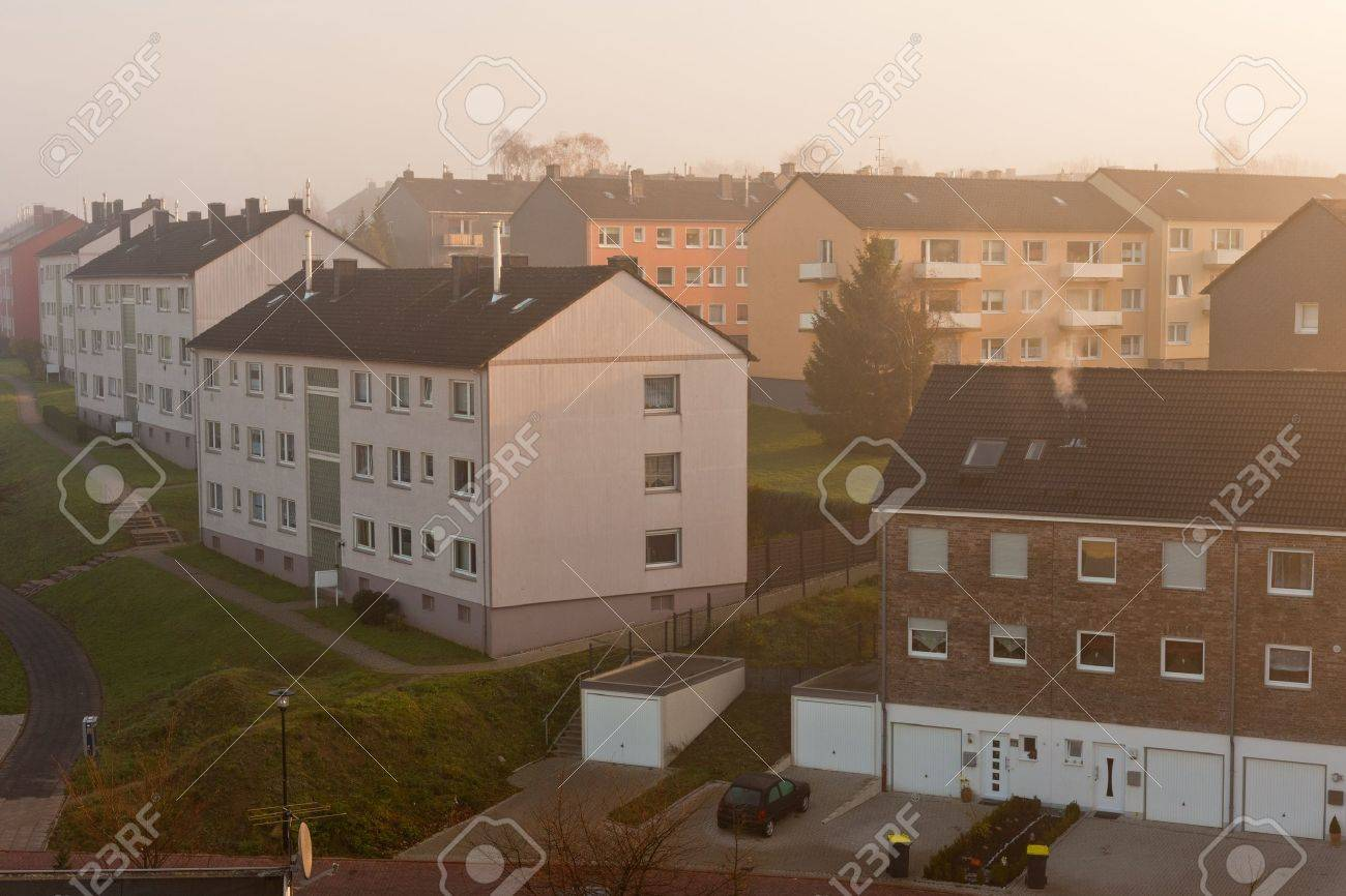 Morning Fog In Typical German Small City Suburb Of Apartment - Small apartment buildings