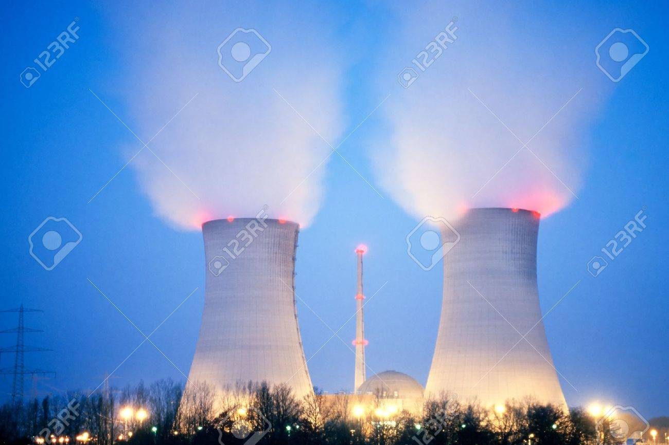 Nuclear power plant blowing huge clouds into dusky sky. Stock Photo - 14145205