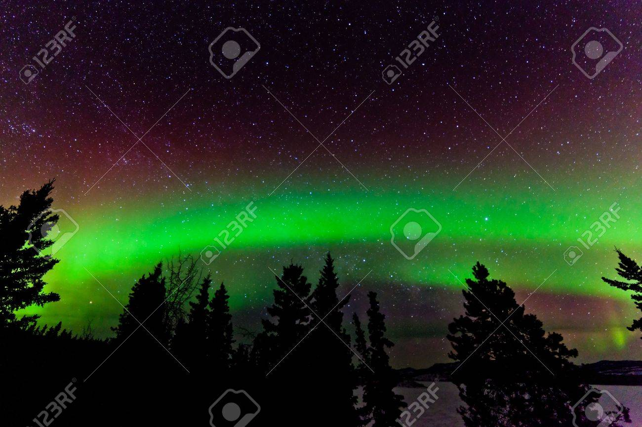 Green Glowing Display Of Northern Lights Or Aurora Borealis Or