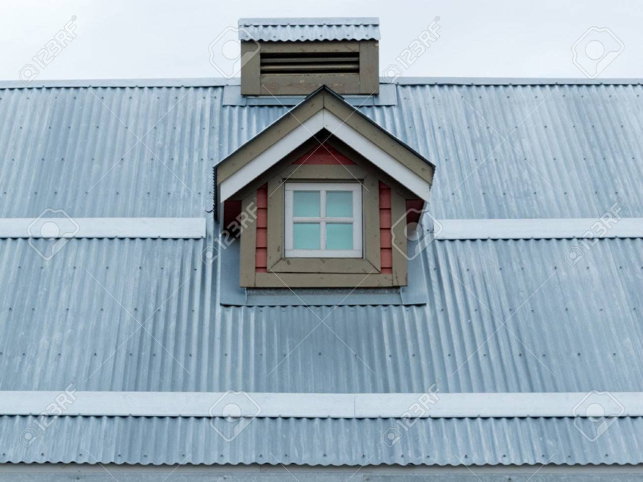 Architectural Detail Of Small Dormer Window In Metal Sheet Roof Of  Residential House Stock Photo