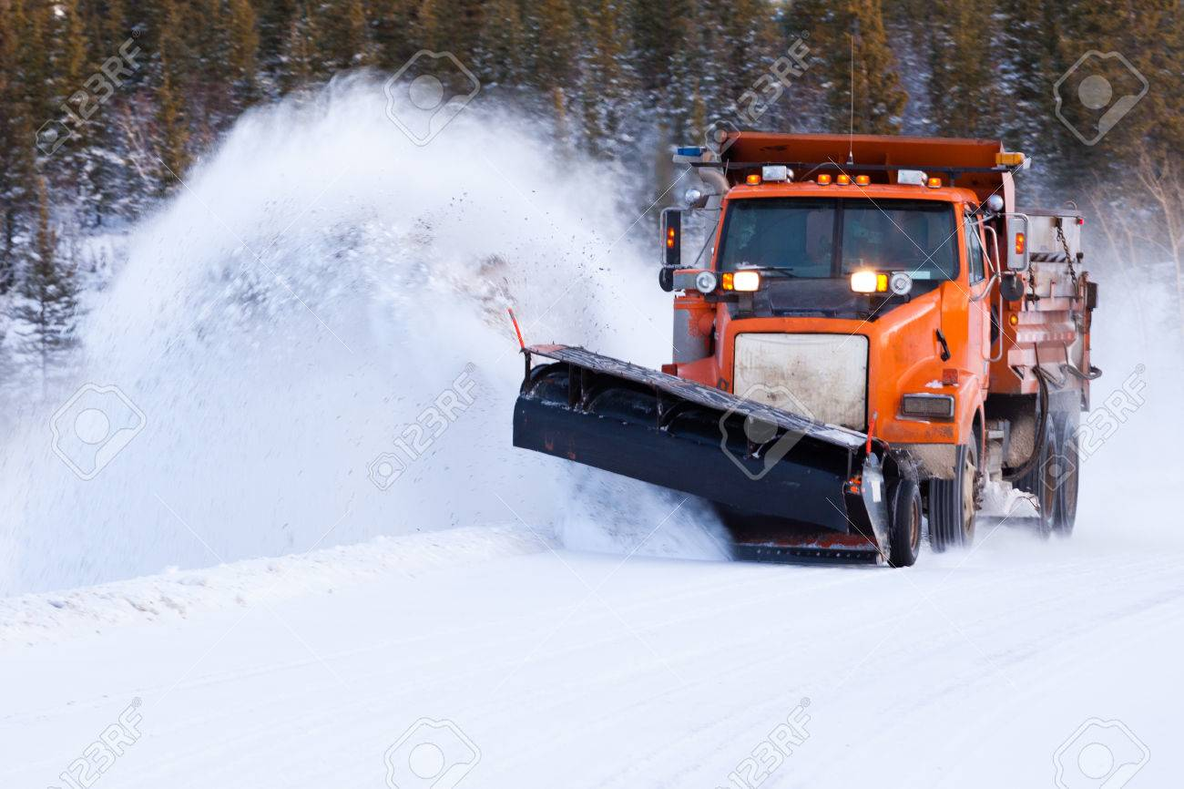 Snow Plow Truck Clearing Road After Winter Snowstorm Blizzard