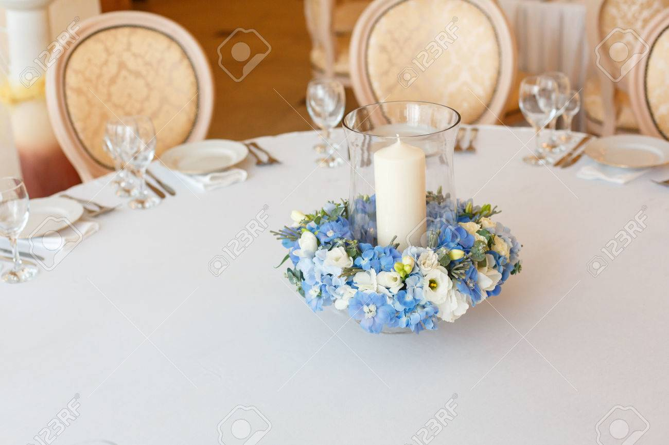 White Table Candle Blue Flowers Arrangement Decoration Interior Stock Photo Picture And Royalty Free Image Image 73247728