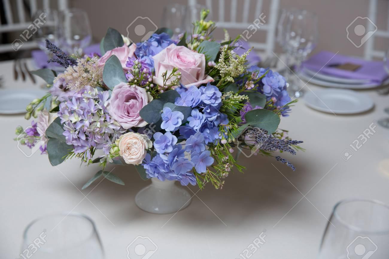 Wedding Flower Arrangement With Blue Violet Pink Flowers Stock Photo