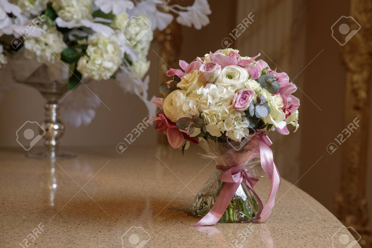Small Bouquet On The Table With Red And White Flowers Stock Photo