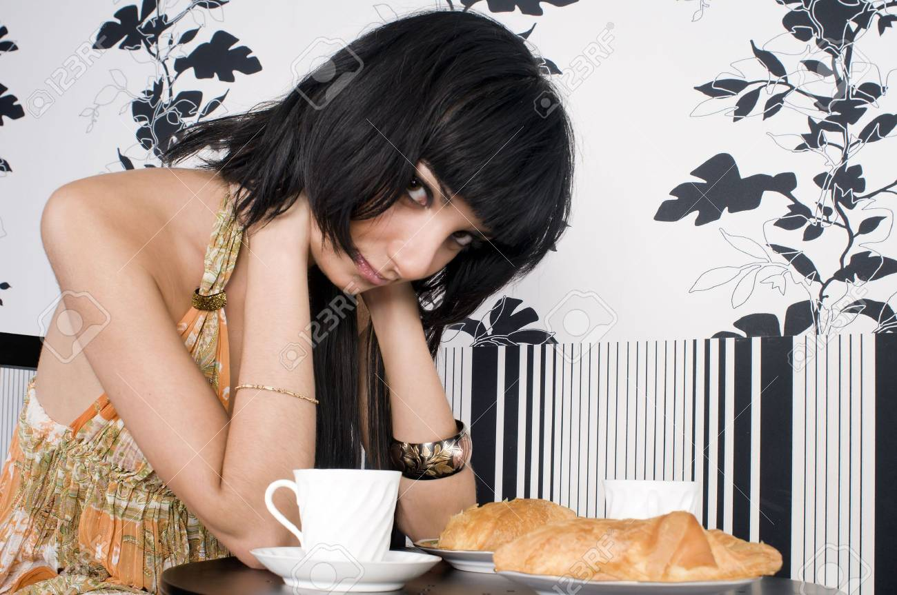 Beautiful brunette girl is waiting for someone in the cafe Stock Photo - 4411944