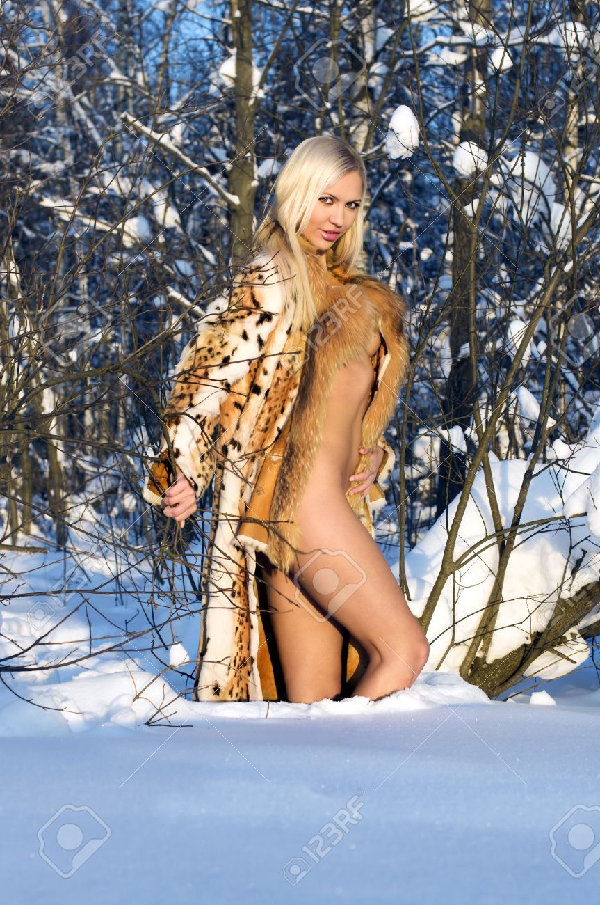 Naked Beauty In Furs In The Winter Forest Stock Photo, Picture And