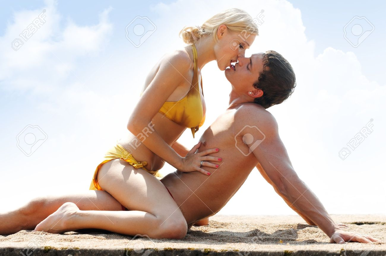 Romantic Kiss On The Beach