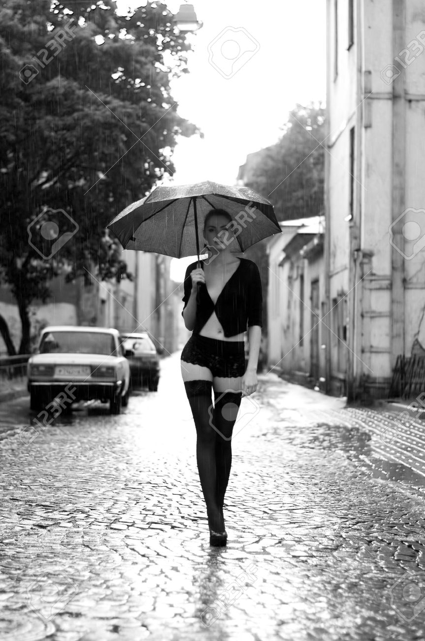 Potrait of the beautiful woman walking in the rain. Monochrome image Stock Photo - 8103287