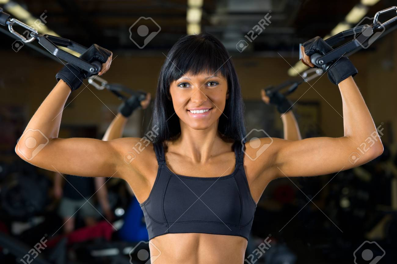Beautiful woman is doing exercises at the gym in the sport club. Stock Photo - 11547473