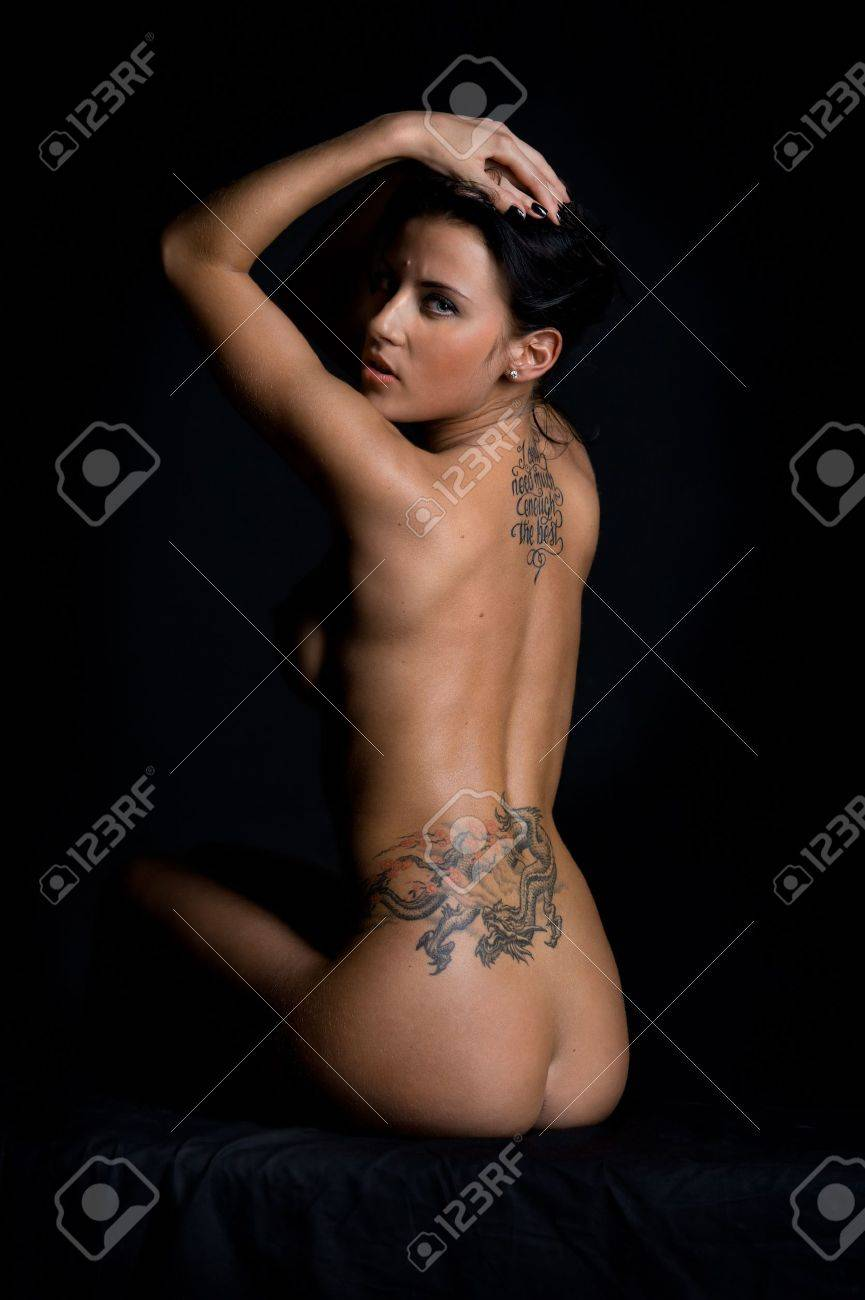 Back Of The Beautiful Naked Woman With Tattoo. Photo With Dark ...