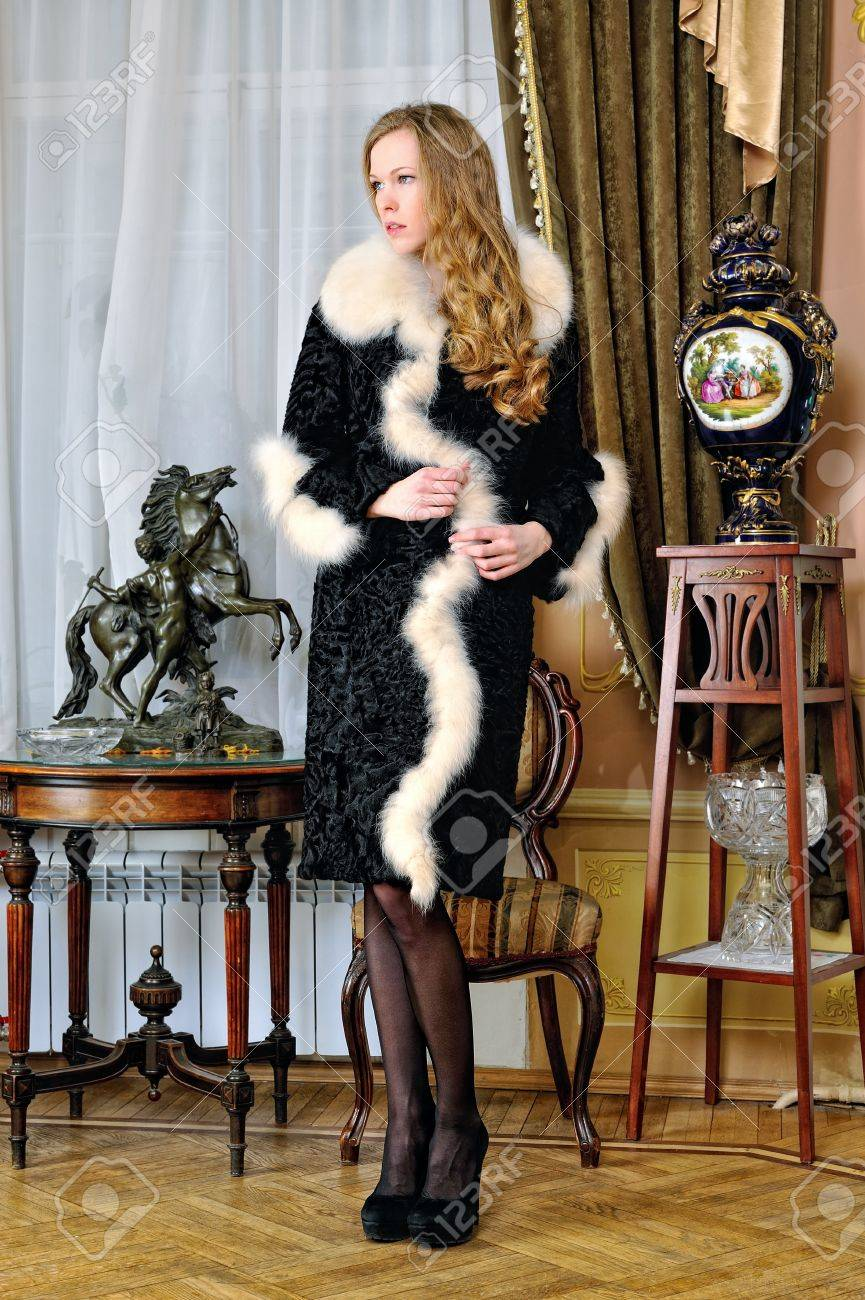 Beautiful Woman In Fur Coat In Classical Antique Interior. Stock ...
