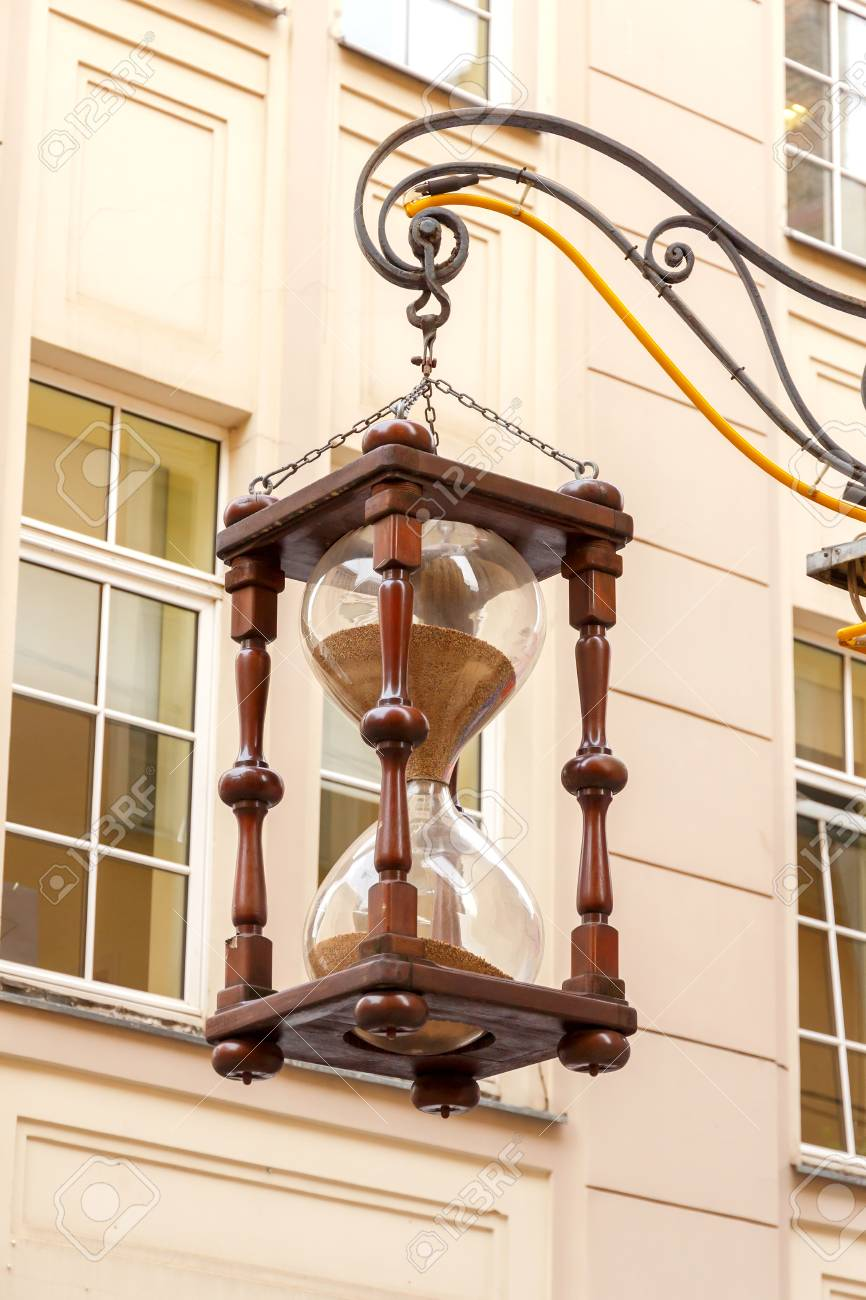 Decorative Hourglass On One Of The Oldest Streets Of Riga Stock - Decorative-hourglass