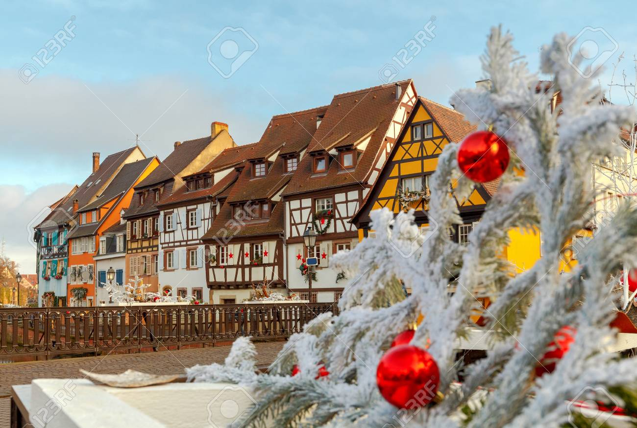 Christmas Day In France.Medieval Multicolored Half Timbered Houses On Canals On Christmas