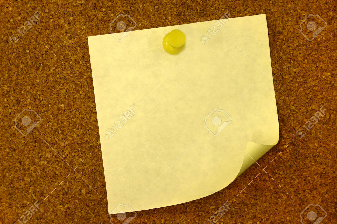 yellow curled blank memo on bulletin board copy space stock stock photo yellow curled blank memo on bulletin board copy space
