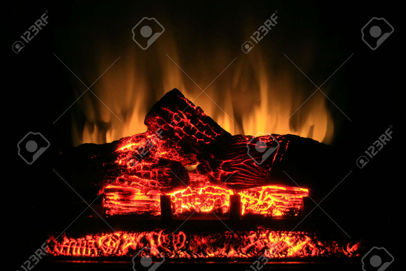 Glow from a realistic looking electric fireplace. Stock Photo - 5806205