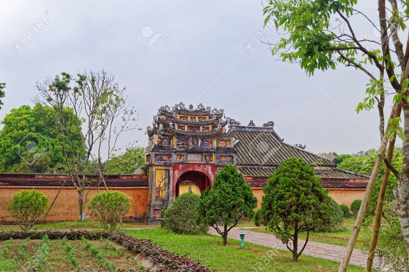 One of the gates to the inner area of Purple Forbidden city (Imperial Citadel) in Hue, Vietnam - 131588188
