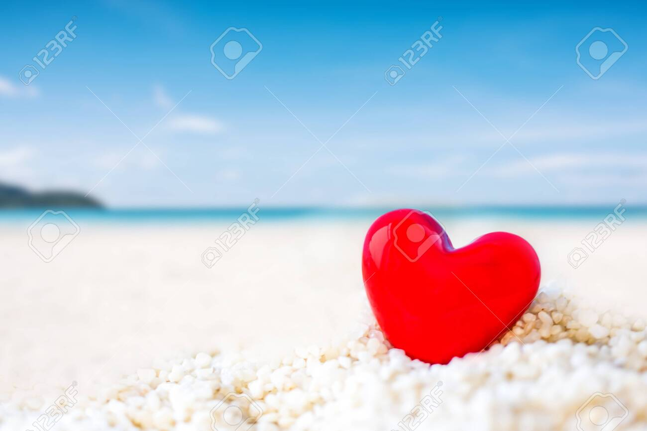 red Heart shape on white sand beach ,Image for love valentine day or summer vacation concept - 150645677