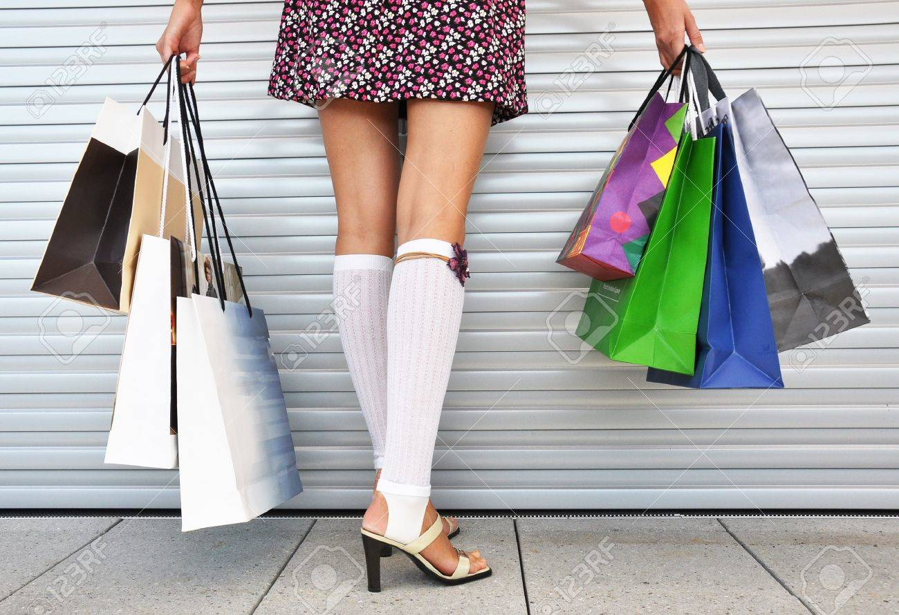 Girl With A Bunch Of Shopping Bags Stock Photo, Picture And ...