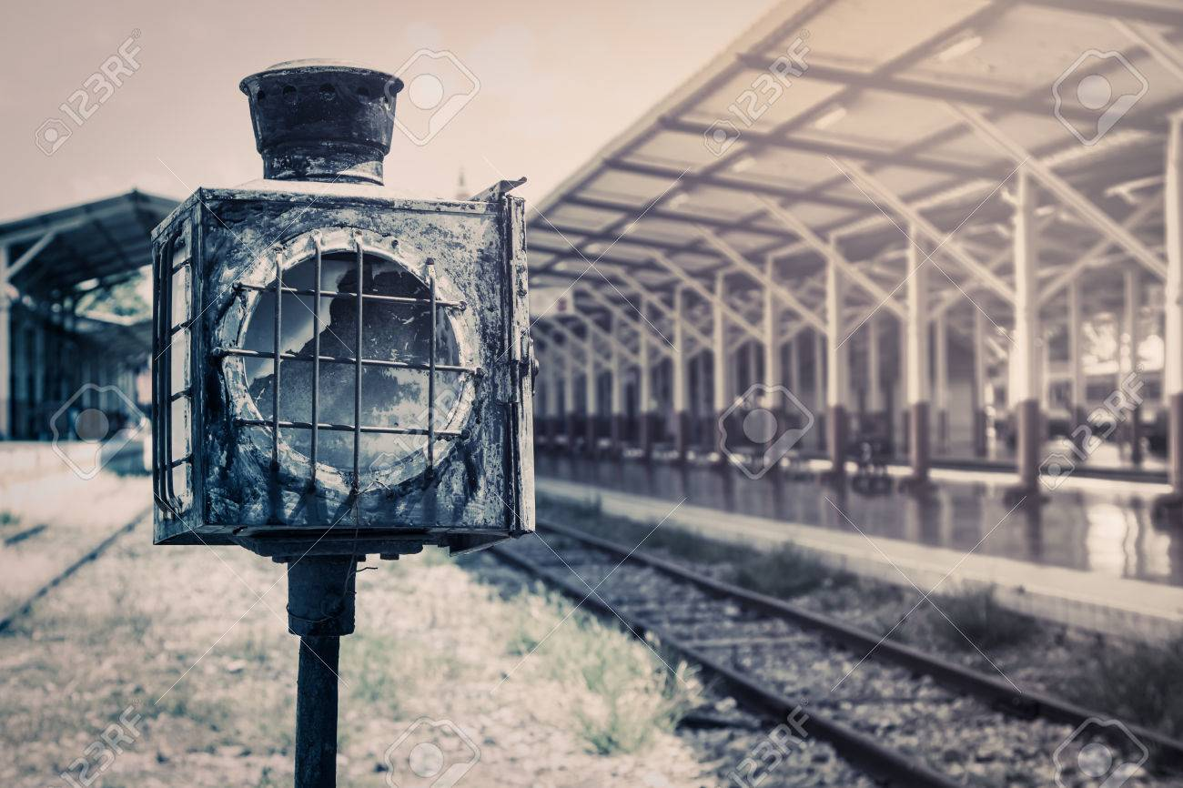 old lamp pole in railway station in vintage filter