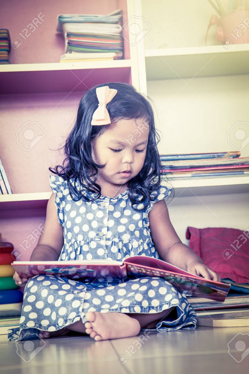 Child Read Cute Little Girl Reading A Book And Sitting On Floor Vintage