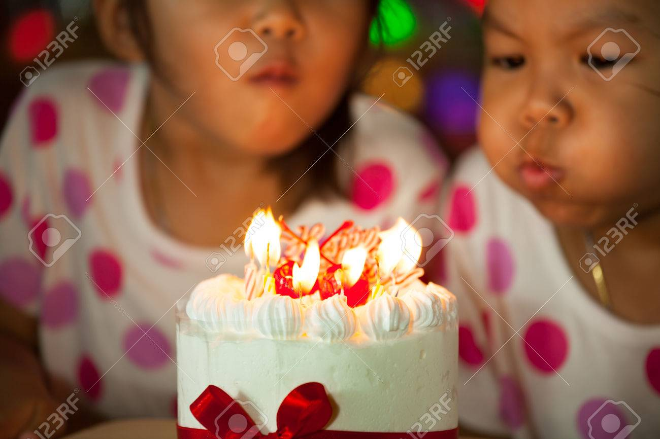 Miraculous Happy Twin Two Asian Little Girls Celebrating Birthday And Blowing Funny Birthday Cards Online Inifofree Goldxyz
