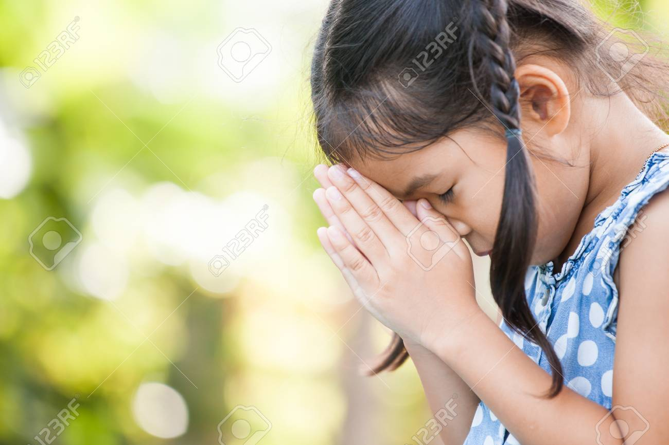Cute asian little child girl praying with folded her hand for faith,spirituality and religion concept - 85573413