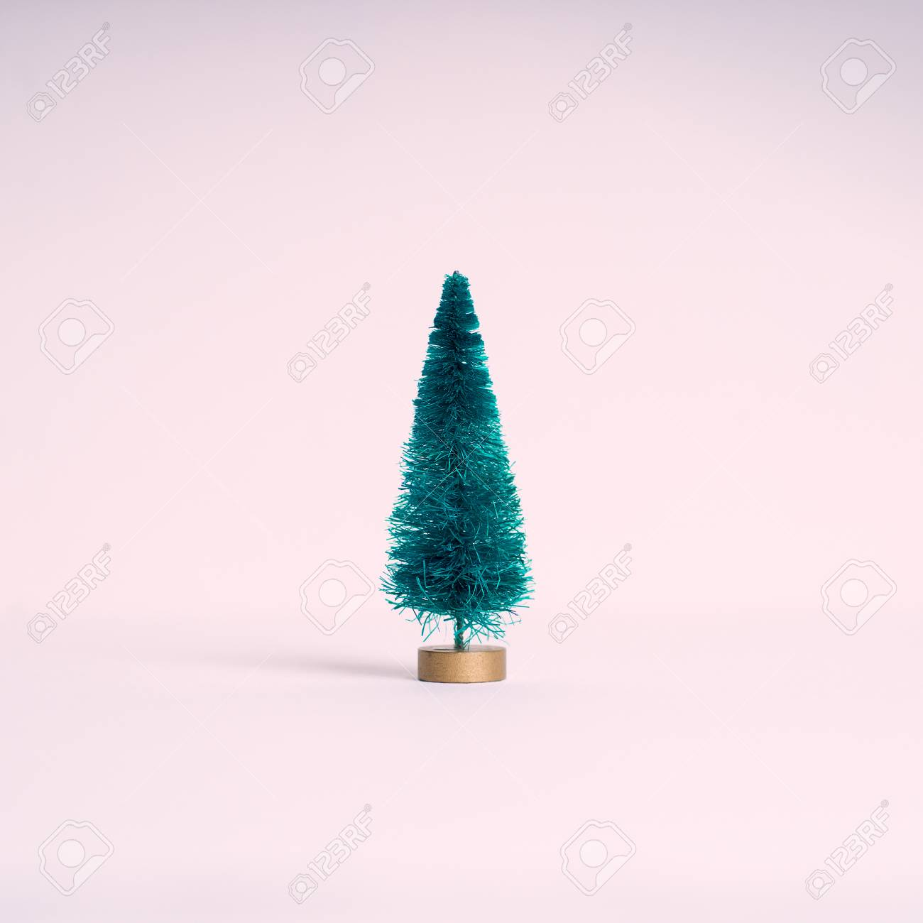Pink Artificial Christmas Tree.Small Artificial Christmas Tree On Pink Pastel Background Minimal
